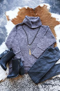 Fall in love with fall in style! This soft turtleneck sweater is sure to keep you warm, cozy, & blissfully happy. - 70% Polyster, 30% Nylon - Dry clean - Neckline: Turtleneck/cowl neck - Side slits -