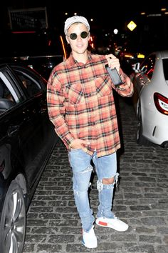 Justin Bieber wearing Fear of God Selvedge Denim Vintage Indigo Jeans, Fear of God Plaid Flannel Shirt, Adidas Nmd Runner Pk and Urban Outfitters Snoopy Baseball Cap