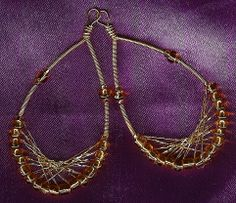 """A brand new design~! I had been considering something along these lines, when I saw an incredibly similar pair on an episode of """"White Collar"""". I knew then, that I had better get crafting- and here they are! Beaded and woven earrings sparkle warmly in yellow gold color with vintage beads, and a highly reflective metallic thread. Totally vegan- for those who adhere to that lifestyle."""
