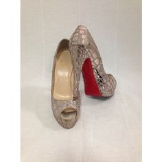 """Steal the scene with these Christian Louboutin """"Sobek"""" Mosaic patent peep toe pumps. They feature a satin and mirrored patent leather upper ..."""