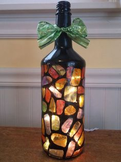 Bottle Lamps - Are you looking for a gift for that hard to buy person? Why not check out Etsy? All the bottle crafts sold are hand made, unique crafts. Diy Bottle Lamp, Glass Bottle Crafts, Wine Bottle Art, Painted Wine Bottles, Lighted Wine Bottles, Bottle Lights, Glass Bottles, Decorated Bottles, Diy Lampe