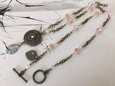 Pretty in Pink! This Uniquely Handcrafted Bronze Necklace with lots of Sparkle! Handmade Necklaces, Handcrafted Jewelry, Necklace Lengths, Necklace Set, Fashion Jewelry, Women Jewelry, Sparkly Jewelry, Bronze Pendant, Jewelry Making