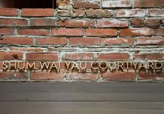 Pin-mounted letters applied to the brick in the museum courtyard. Museum of Chinese in America