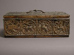 Box ( back view)  Date: 13th century Culture: German Medium: Lead, gilding, wood, gesso, copper alloy handle and lock plate, traces of red textile Dimensions: Overall: 3 3/4 x 9 5/16 x 5 3/16 in. (9.6 x 23.7 x 13.2 cm) Lid without handle: 7/16 x 9 5/16 x 5 3/16 in. (1.1 x 23.7 x 13.2 cm)
