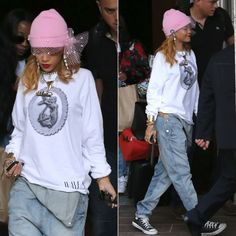 Rihanna in Silver Spoon Attire pink mesh bow beanie and cameo mermaid sweatshirt, Topshop denim overalls, Converse black high-top sneakers, Tom Binns crystal and gold shark tooth necklace