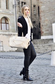 Kristina Bazan of Kayture wears a ZARA top, blazer, and booties, H&M jeans, and REED KRAKOFF bag. (March 1, 2012)