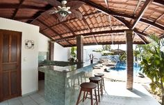 Pool side Gazebo with grill - Enjoy and socialize at our pool side gazebo with grill and half bathroom at Villa Jaco Sol vacation rental in Jaco, Costa Rica, walking distance to the beach and downtown.