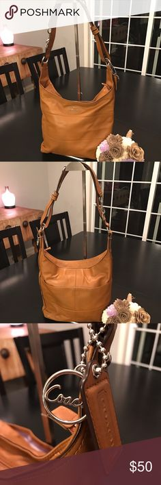 Coach Saddle Cross Body/Shoulder Bag Gorgeous Coach Saddle Cross Body/Shoulder bag! Features an adjustable strap to shorten or lengthen to meet your needs. Slight shadow where there is dark color transfer around the stitching on the back center of the bag. Coach Bags Crossbody Bags