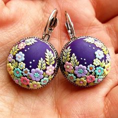 Many of you asking me for these earrings, if I can make them again.... And I did for one of my customers...  You can find yours in my etsy shop. All jewelry is handmade with a needle. . . . . .  #earrings #earring #handmadewithlove #purple #mintgreen #pastel #pastelcolors #etsy #etsyshop #etsystore #colour #colorfulart #colorful #mint #violet #plum #lilac #embroidery #handembroidery #embroideryart #miniatures #miniature #microart #whphowicreate #handmade #blossoms #blooms #blooming #colo