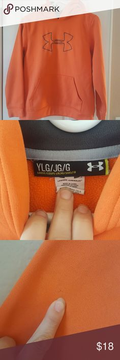 Under Armour hoodie Orange UA hoodie, size Youth LG, good condition except very minor pull on back of arm and a small paint stain in back of arm, see pics. paint should be able to be taken off, just haven't tried yet. Very comfy hoodie! soft! Under Armour Shirts & Tops Sweatshirts & Hoodies