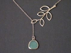 Five Leaf Branch And Fancy Drop Opal Green Pendant -16k Yellow Gold Plated Or White Gold Plated Lariat Necklace. $22.00, via Etsy.