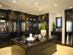 Masculine Closet: A shrine to clothes lovers everywhere, this walk-in closet boasts the size of a spacious garage and is gloriously appointed by Meridian Interiors. From HGTVRemodels.com