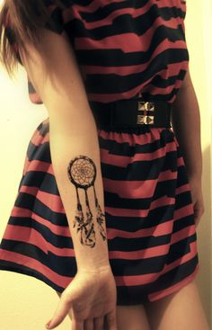Dreamcatcher wrist tattoo. Much smaller, actually lots of symbolism because of my grandma
