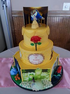 Disney Princess themed birthday cake for Icing Smiles.  #bakingadifference Belle, Ariel,  Cinderella, Tiana, Jasmine, Sleeping beauty and Rapunzel.