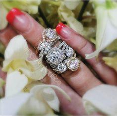 Why hello, halos.  #theknotrings #dgellerandson #uniqueengagementring #haloring #diamonds #pavediamonds #rounddiamond #cushioncut