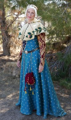 Angele Plaisance/Diane Lynn in 15th century French working class gown. The gown is Dupioni silk stenciled with small star pattern.