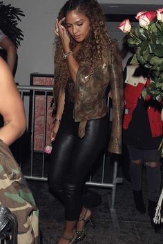 Cassie Ventura wearing leather cropped pants, leather jacket, leather pants.