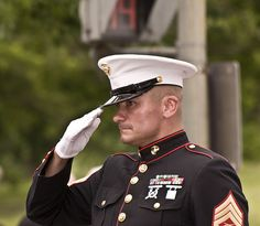 Marine standing his post during Rolling Thunder 2009. This Marine stood his post for many hours in the heat as several hundred thousand motorcycles passed by honoring our country's fallen remembering those who have yet to return home. Showing the strength and courage of those who gave so much for us to be free.