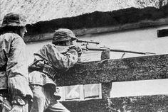 [Photo] German SS soldier with Gewehr 98b sniper rifle, date unknown