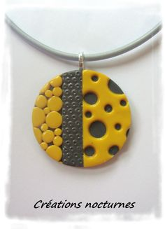 Polymer clay pendant by creations_nocturnes
