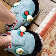 These slippers are created to look like real zombie heads, with popping out eyes, blue-toned skin, and blood soaked teeth.