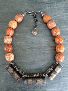 by Anna Holland   Necklace; 3 antique prayer boxes, probably Ethiopian, with some beautiful crackled African beads, antique silver spacers, and a Thai silver extender with an Ethiopian telsum bead   995$