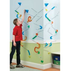 EXTREMELY COOL, too bad the price is a bit 'steep' for us grandparents!  Wall Mounted Marble Roller Coaster, Hammacher Schlemmer: wall-mounted marble roller coaster kit that allows children to design & build a vertical track that sends marbles on exhilarating, sheer descents.