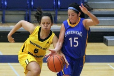 LU's Carolyn Fragale (right) and Waterloo's Cheryll Paranaque battle for a loose ball Saturday night at the Thunderdome.
