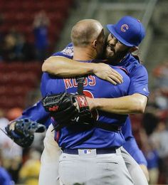 David Ross and Jake Arrieta, CHC, after Arrieta throws a no hitter at…