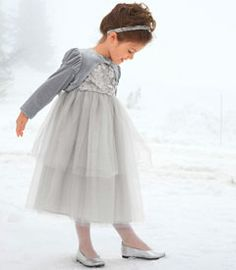 silver dress with silver shrug and shoes