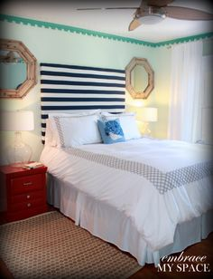 Wonder if it will work with a piece of painting canvas. Then paint stripes or another design.  striped headboard DIY - with instructions