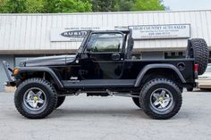 "Jeep LJ Rubitrux AEV Pintler Argent 35"" tires side angle"