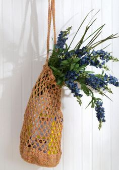 Crochet an eco-friendly bag to carry fresh produce from the farmer's market, daily essentials, or to tote your refillable water bottle. This is a quick and easy bag crochet pattern in eco-friendly cotton yarn.