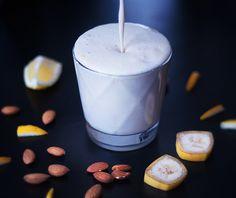 Lemon Smoothie: 1 c Almond Milk, Juice of 1/2 Lemon, 1 slice (ring) of Lemon - rind and meat, 1 Banana, 1/2 Vanilla pod (optional, but recommended), 1 tsp Honey. Blend.