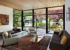 I love the ceiling and aggregate concrete flooring in this Eichler remodel. Those floor to ceiling black frame windows are perfect!