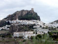 Zahara de la Sierra (pueblo blanco de Andalucía) ***photo by Robert Bovington***  Zahara de la Sierra can be seen from miles away because it is situated in one of the most dramatic locations of all the White Towns. Its 13th-century Moorish castle stands high on a rocky outcrop overlooking the sugar-cubed houses of the village that also enjoys a hilltop setting.