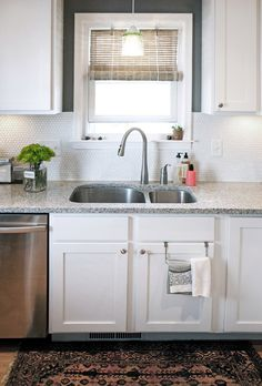 why do i love this sweet little kitchen? it's clean and modern (love that backsplash tile), but still has old-fashioned touches, like the windo over the sink.