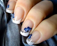 Give your next French manicure a twist with painted on blue flowers. These nails are great for everyday wear.