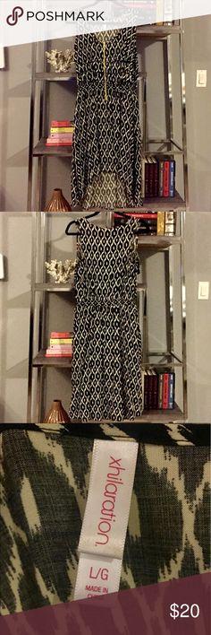 Xhilaration Black & White Asymmetrical Dress Black and white a-line asymmetrical dress. Very comfortable. Worn twice. Built-in elastic cinch at the waist. Neon zipper. Xhilaration Dresses Asymmetrical
