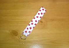 Key ring for the wrist, handmade in cotton fabric, white with red strawberries £3.99