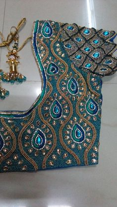 In this video you can see 20 aari work blouse, especially for bride. Cut work embroidery design, complete bead work designs and two st. Kerala Saree Blouse Designs, Cutwork Blouse Designs, Patch Work Blouse Designs, Wedding Saree Blouse Designs, Maggam Work Designs, Fancy Blouse Designs, Peacock Embroidery Designs, Mirror Work Blouse Design, Blouse Designs Catalogue