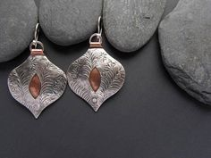 Mixed Metal Drop Earrings Silver and Copper Artisan Metalsmith OOAK • hand cut from sterling silver and copper sheet, embossed, hammered, filed, sanded, pierced, riveted, oxidized, assembled, tumbled, polished • sterling silver and copper • all components hand made • sterling silver ear