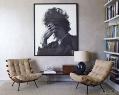 A pair of '60s Brazilian chairs and a photograph of Bob Dylan by Jerry Schatzberg in the living area.