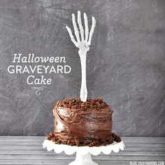Take a chocolate cake from sweet to spooky with some crumbled brownie and a skeleton cake topper.