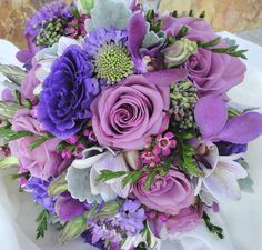 Hand tied bouquet ....mixed spring to include Cool Water roses by Flowers by Fudgie