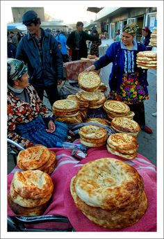 Not merely bread, Krytyy Market, Bukhara, Uzbekistan. For the Uzbeks, 'non' is sacred and more than just food; it's a sign of well-being and traditionally in rural areas, the first thing people bring with them as a gift is 'non' and when leaving, the host won't say goodbye without giving them another 'non'.