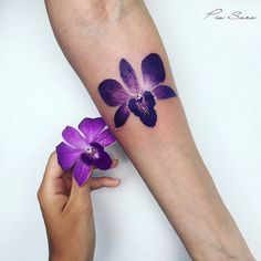 30 Gorgeous Orchid Tattoo Designs and Ideas - TattooBloq Orchid Flower Tattoos, Flower Tattoo Back, Small Flower Tattoos, Flower Tattoo Shoulder, Small Tattoos, Orchid Flowers, Purple Tattoos, Rose Tattoos, Body Art Tattoos