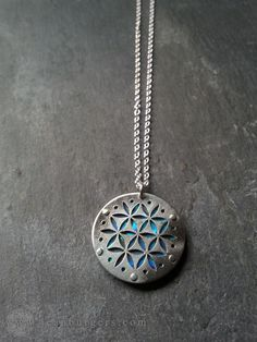 Small Blue Flower of Life pendant on chain - Handcrafted Sacred Geometry Jewellery by JeanBurgersJewellery on Etsy https://www.etsy.com/listing/128952514/small-blue-flower-of-life-pendant-on