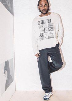 Kendrick Lamar wearing a white long sleeve 'Art Brut Dubuffet' t-shirt by Enfants Riches Déprimés