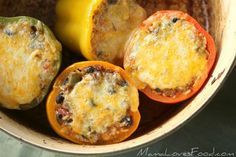 Easy Mexican Stuffed Peppers recipe is a simple and delicious! Cheese, beans, rice, peppers and seasoned ground beef come together for a delicious meal!